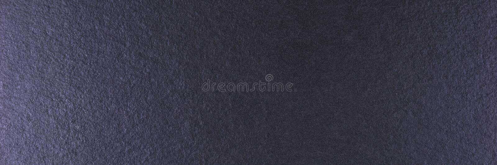 Black stone or slate background, black texture royalty free stock photo
