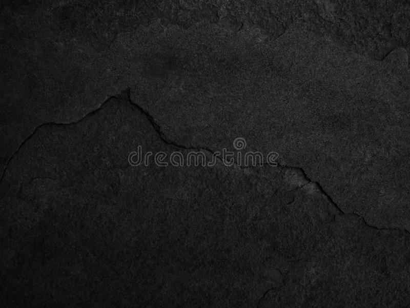 Black stone, slate texture background.  stock images
