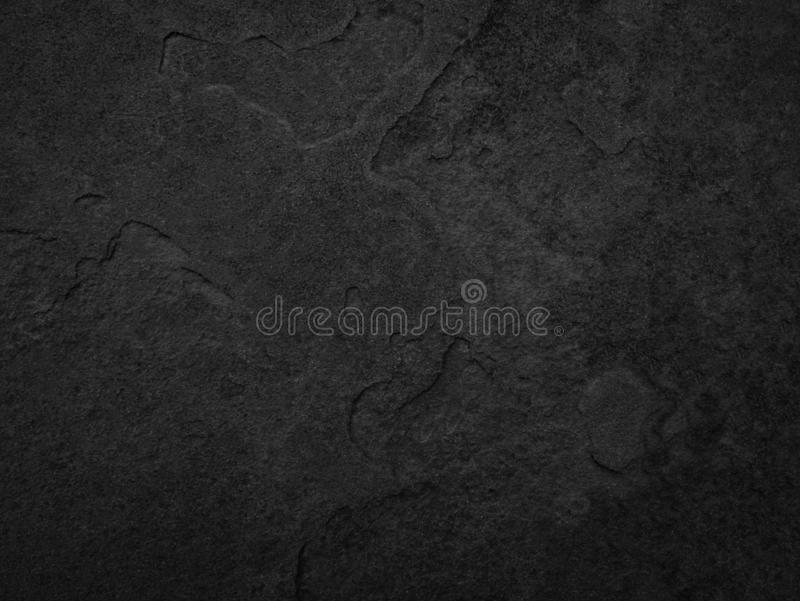 Black stone, slate texture background.  royalty free stock images