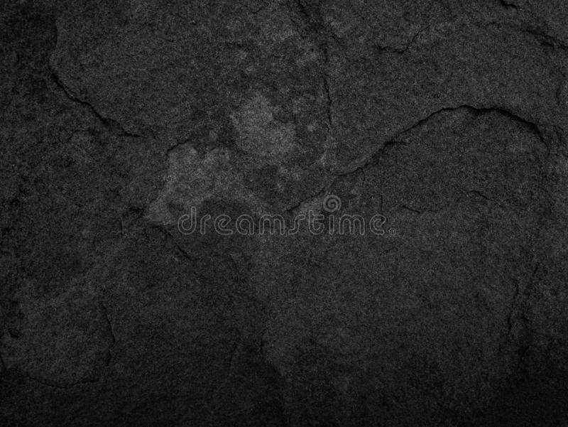 Black stone, slate texture background.  stock image