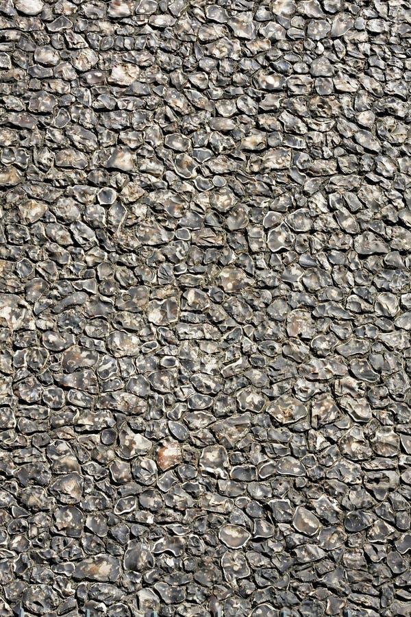 Black stone wall. Big wall made from black stone bricks royalty free stock photography