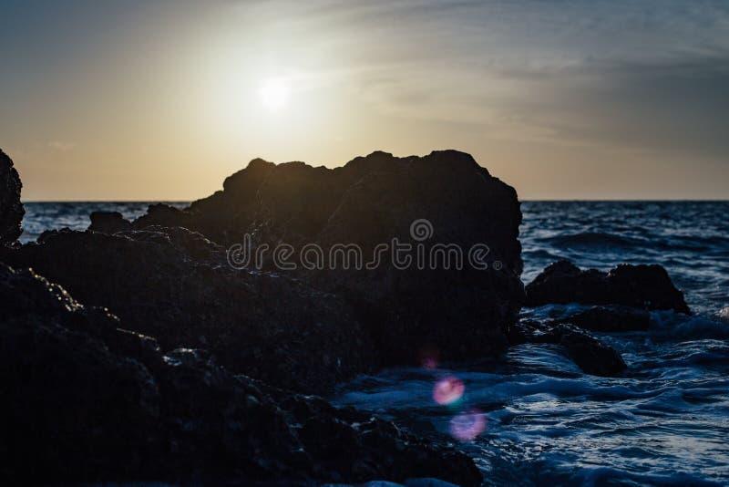Black Stones On Sea Side During Sunset Free Public Domain Cc0 Image