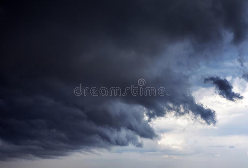Black storm cloud is approaching the sky, a thunderstorm begins. Natural phenomena stock photography