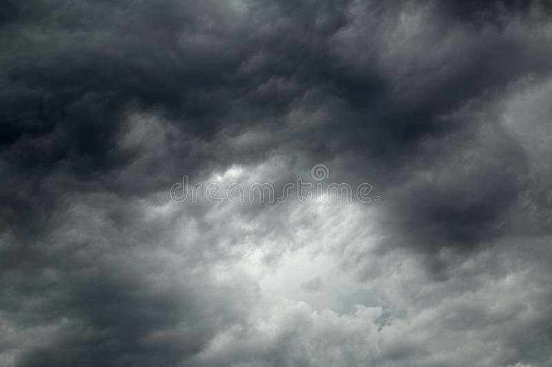 Black storm clouds in the sky. Storm clouds in the sky background royalty free stock images