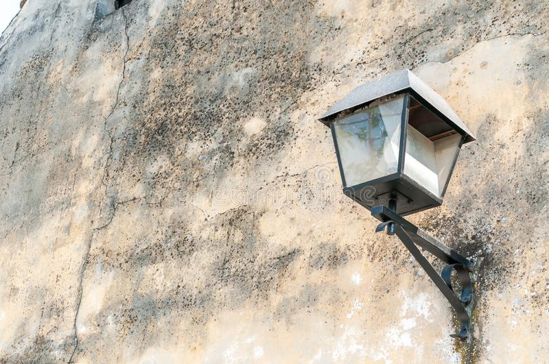 Black street lamp or lantern on the exterior wall facade of house to provide light at the night royalty free stock photos