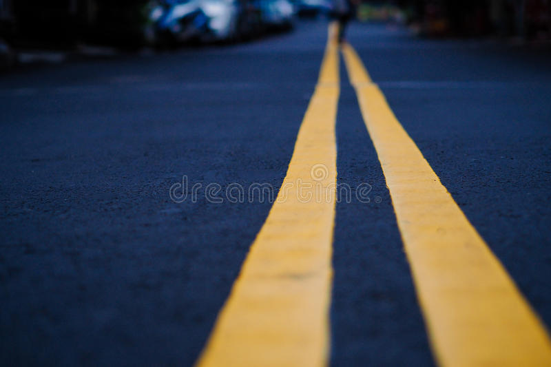 The black street with yellow line, selective focus, blurred back royalty free stock photo