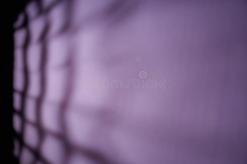 Black stripes in the form of a grid on a violet background stock photography
