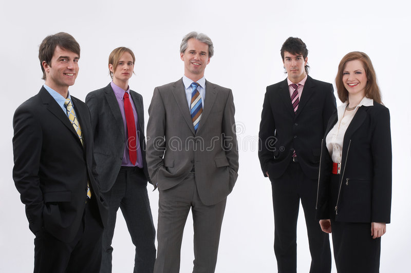 Black suited. Five businesspeople are standing in a row stock photo