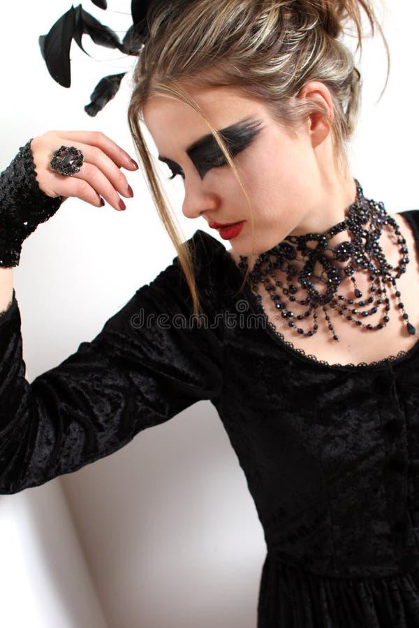Black Swan make-up. Model wearing a black swan make-up royalty free stock images