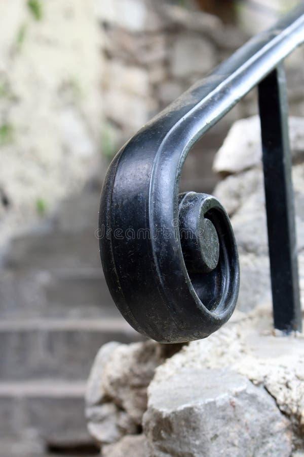 Black swirled metal stair handrail design element stock images