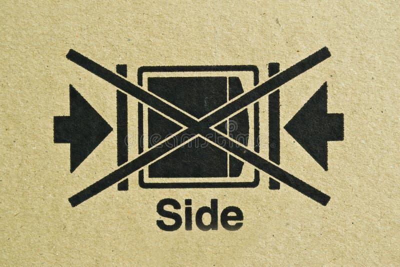 Black symbol on cardboard,. Brown paper box stock photos