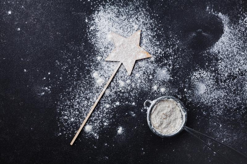 Black table with flour for christmas baking. Top view. royalty free stock photography