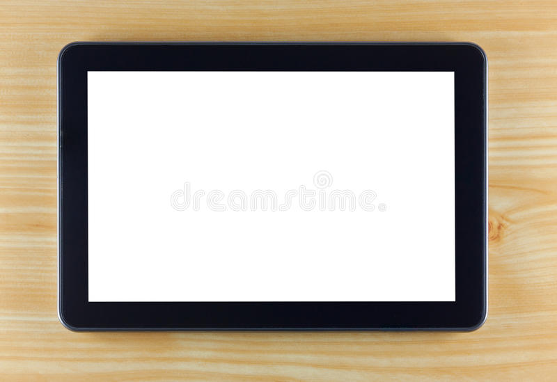 Black tablet computer on wooden background royalty free stock photos