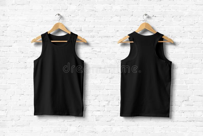 Black Tank Top Mock-up hanging on white wall. stock photos