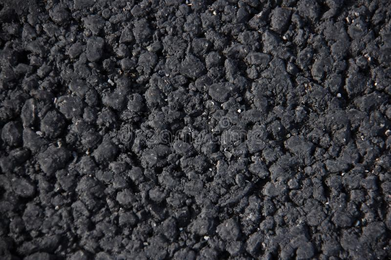 Black tarmac texture useful as a background royalty free stock image