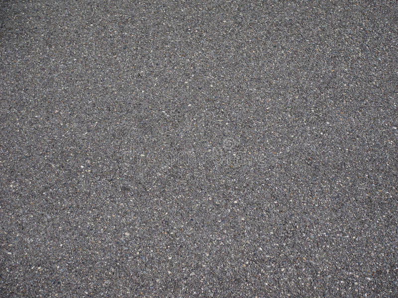 Black tarmac texture background. Black tarmac texture useful as a background royalty free stock photography