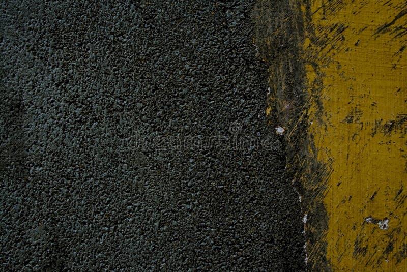 Black tarmac and yellow road marking royalty free stock photos