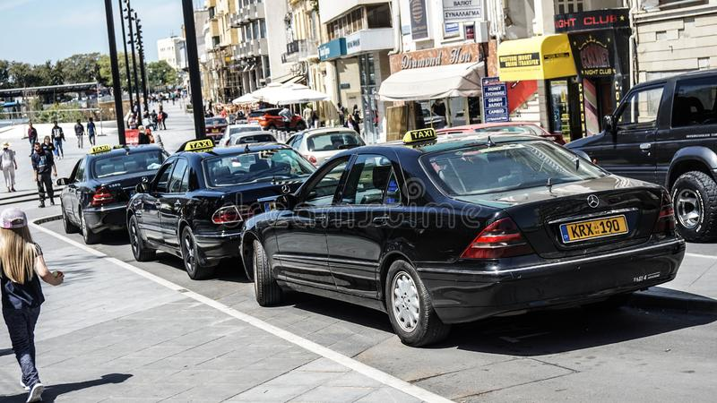 Black taxi cars on the streets of Cyprus in the summer royalty free stock image