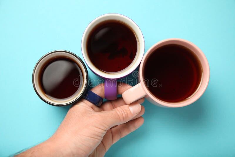 Black tea coffee in bright cups, office break, team building.  stock images