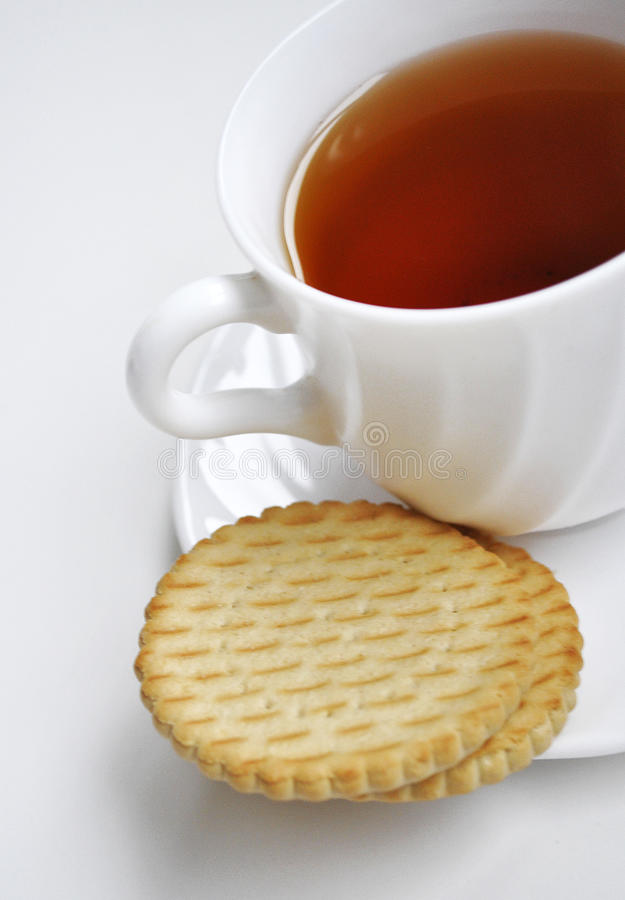 Black tea and cookies stock photography