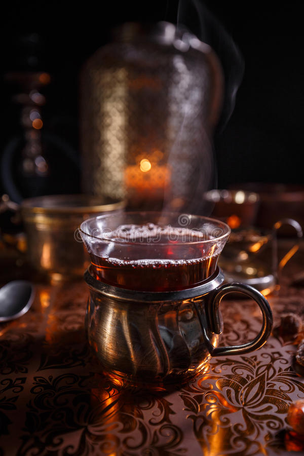 Download Black Tea In Cup And Candles Stock Photo - Image: 83706778