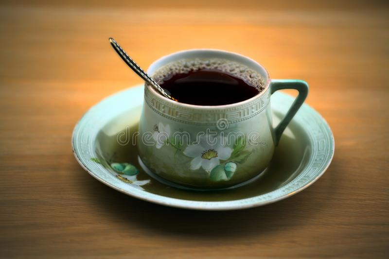 Black tea cup wooden table royalty free stock photos