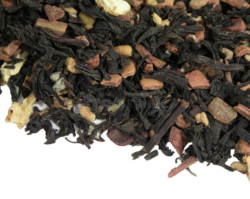 Black tea with dried fruit on a white background. Black tea with dried fruit .Close up stock photos