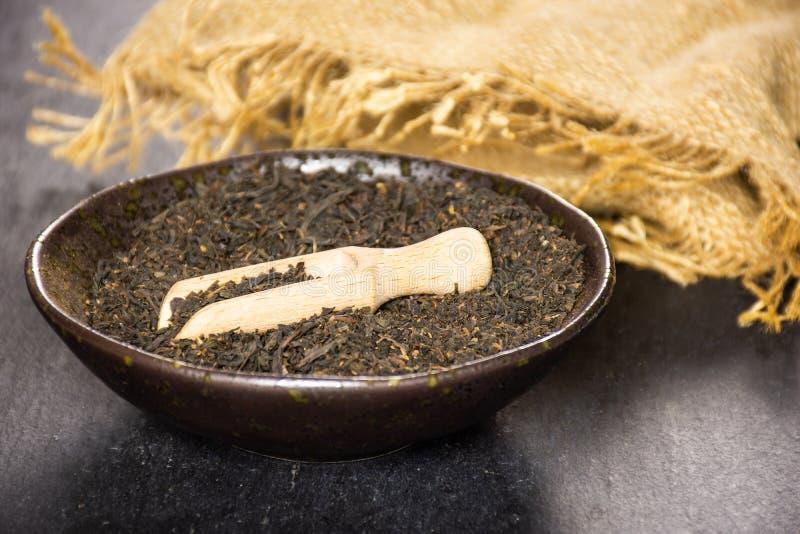 Black tea earl grey on grey stone stock image