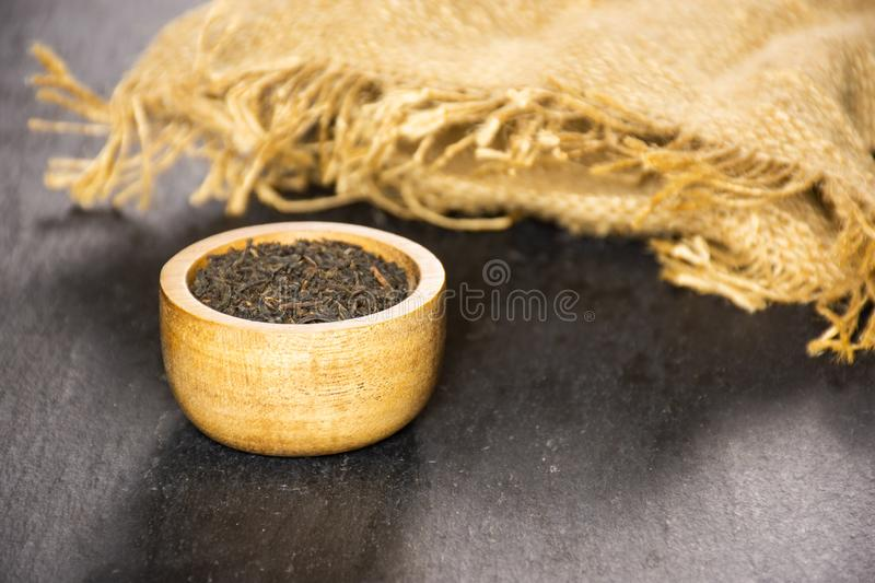 Black tea earl grey on grey stone stock image