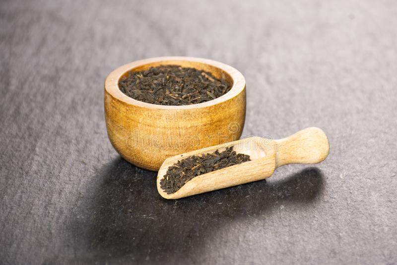Black tea earl grey on grey stone royalty free stock photography