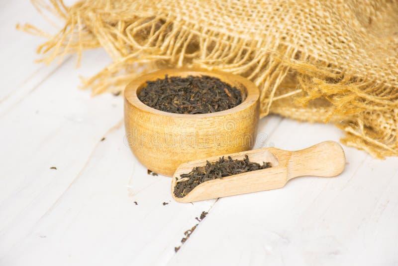 Black tea earl grey on grey wood stock photos