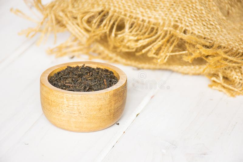 Black tea earl grey on grey wood royalty free stock images