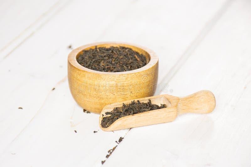 Black tea earl grey on grey wood stock photo