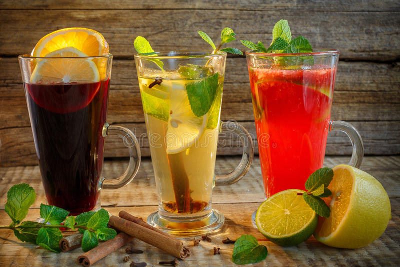 Black tea, green tea and red tea in glass cup with two slices of stock photos