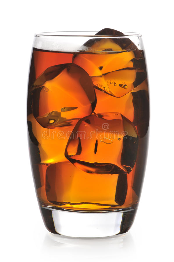 Black tea with ice in glass. On a white background stock photo
