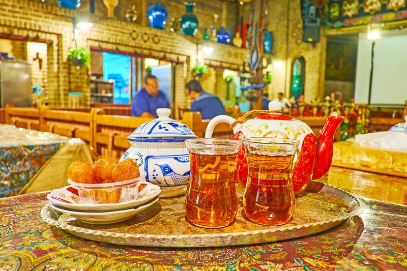 Black tea with Iranian desserts, Azari Teahouse, Tehran, Iran royalty free stock photos
