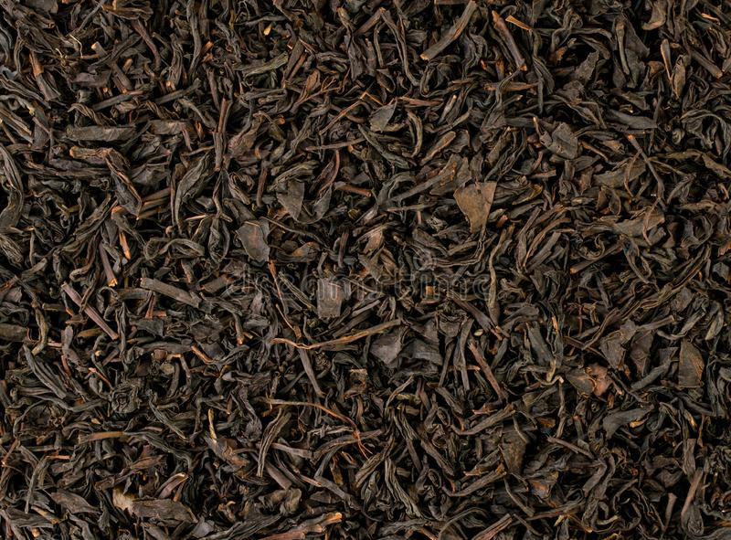 Black tea leaves background view of the top. stock image