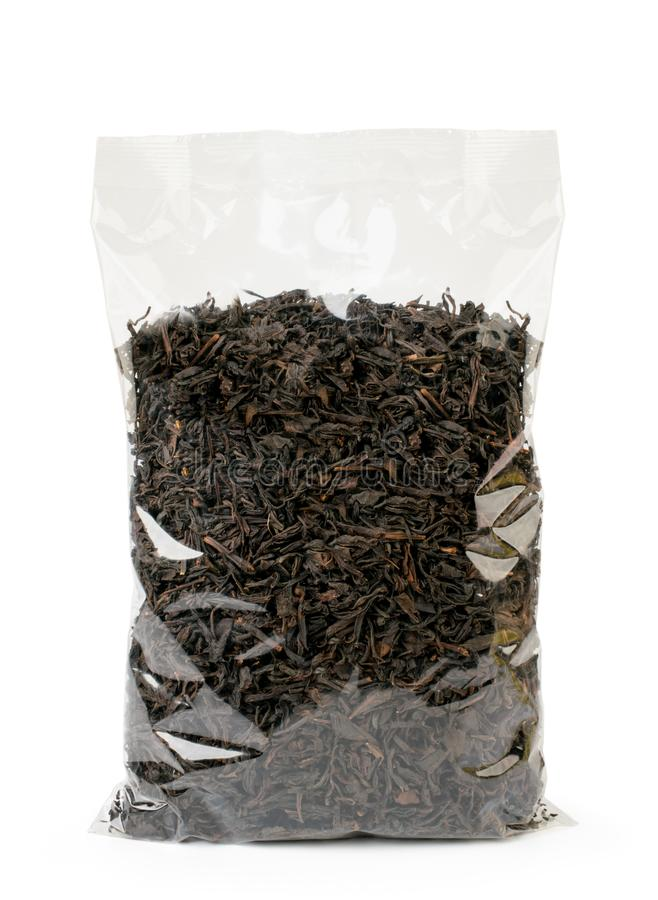 Black tea leaves in a package on a white, isolated. stock photo