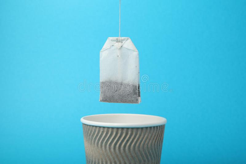Black tea in paper cup, hot beverage.  stock photography