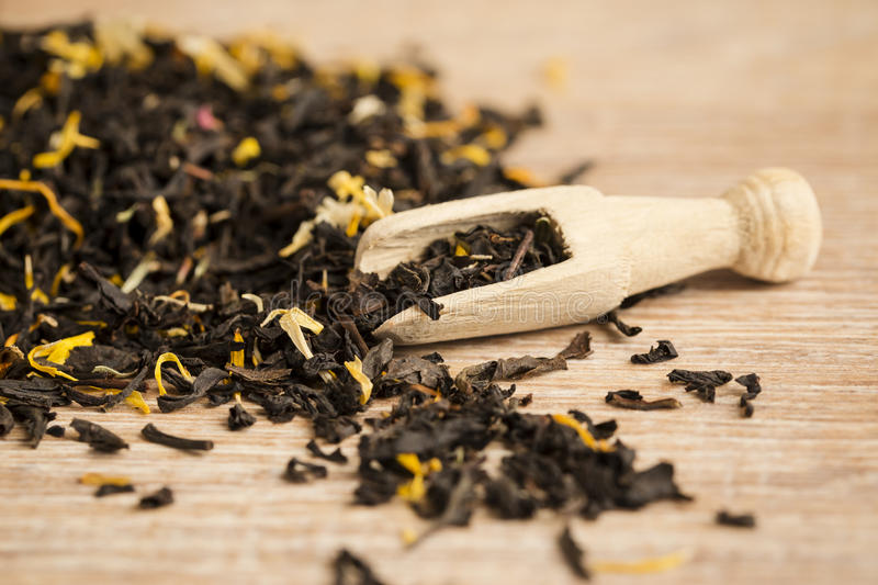 Black tea in a spoon stock image