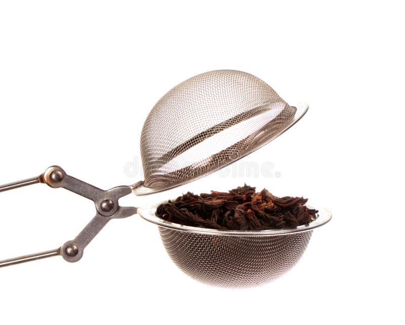 Black tea in strainer. Isolated on white background stock photos