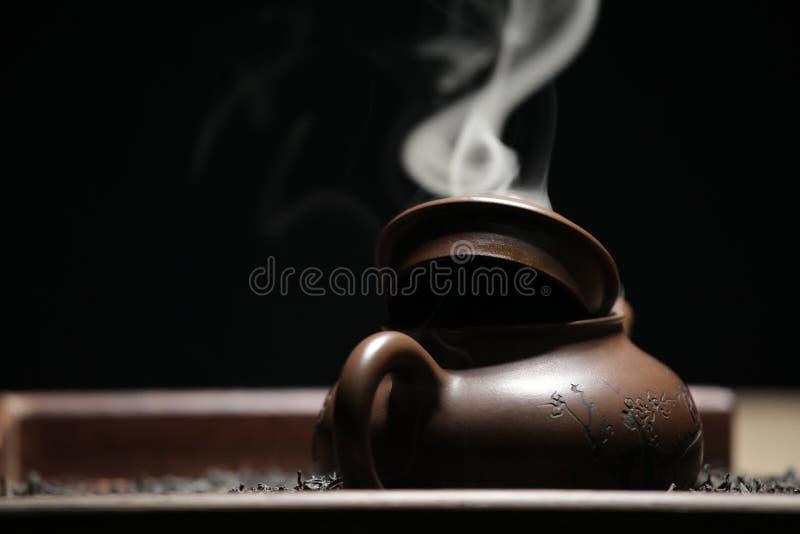 Black tea teapot smoke nobody. Studio stock images