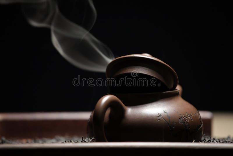 Black tea teapot smoke nobody. Studio royalty free stock photos