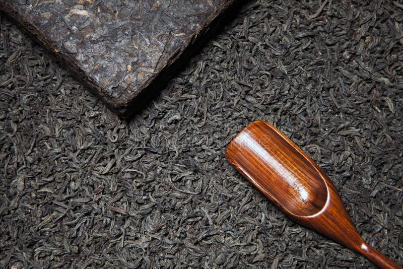 Black tea wooden spoon nobody stock photos