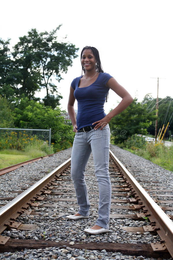 Black Teen Standing On A Railroad Bed Stock Image - Image -4834