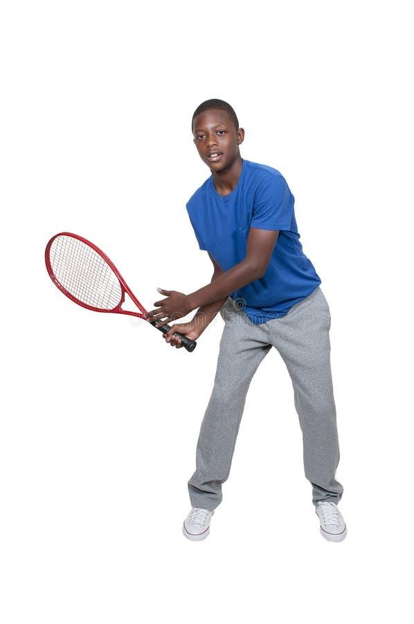 Black Teenager Playing Tennis stock image