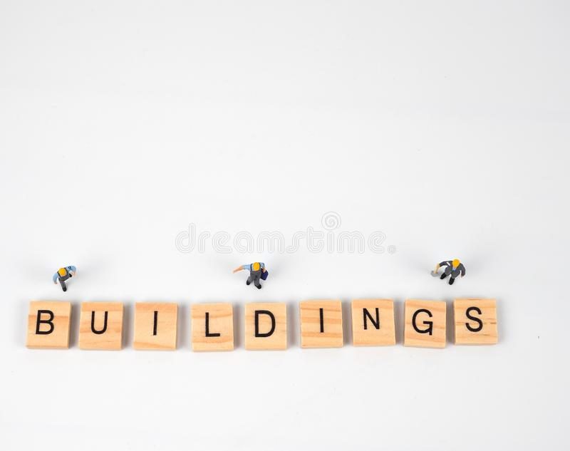 Black text wood The meaning is that the building. stock photos
