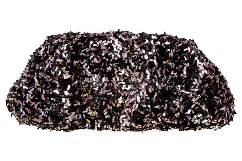 Black textile clutch has soft shape, sparkly handbag royalty free stock photo