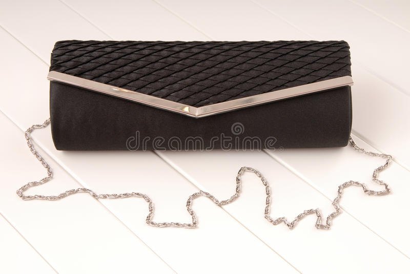 Black textile clutch with silvery chain stock photos