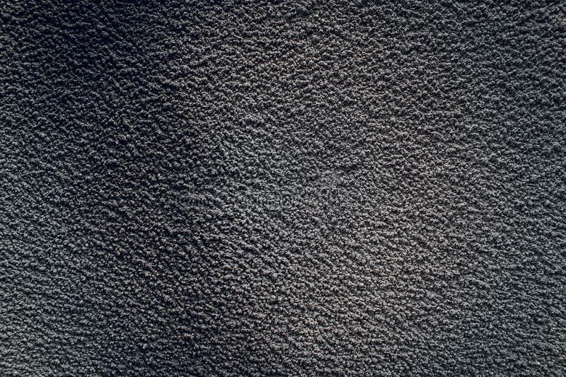 Black texture of an old gray concrete wall. Dark cement backdrop with background on the asphalt. Texture of an old gray concrete wall. Dark cement backdrop with royalty free stock photo